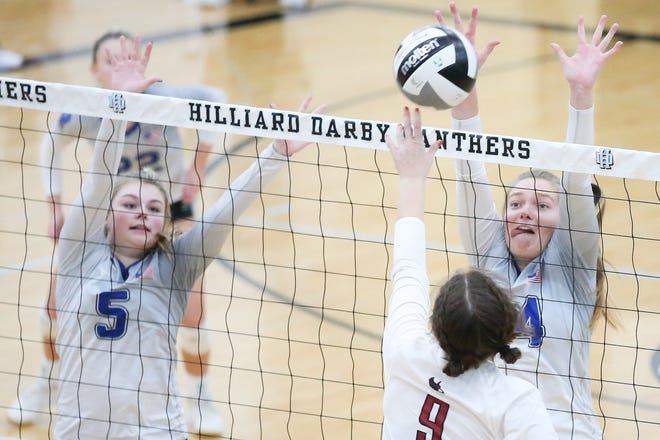 Liberty seniors Ali Sebenoler (5) and Abby Roubinek try to block Watterson's Olyvia Kennedy during a Division I regional semifinal Nov. 5 at Hilliard Darby. The Patriots lost 25-10, 33-31, 25-17 to finish 13-6.