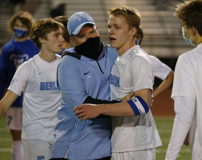 Berlin boys soccer coach Josh Diehl, left, talks with Kyle Rinehart following a 1-0 loss to Thomas Worthington in a Division I regional semifinal Nov. 4. The Bears defeated Westerville Central 2-1 on Oct. 31 in the Division I final to secure the school's first district championship.