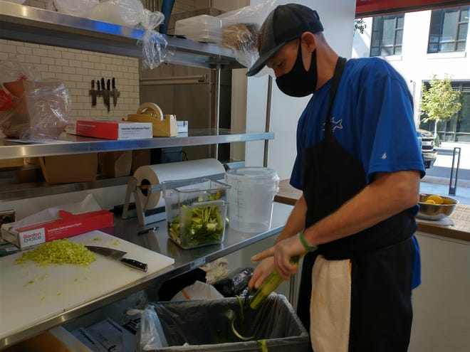 Tony Workman, head chef at Coastal Local Seafood, cuts cucumbers to prepare filling for lobster rolls Nov. 6 at the new North Market Bridge Park,  6750 Longshore St. in Dublin. Coastal Local is one of the first four merchants open at the market.