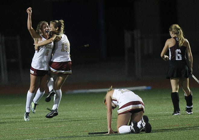 Watterson's Cailin O'Reilly and Alex Picolo celebrate after Picolo scored in the second overtime to give the Eagles a 1-0 win over Columbus Academy in a state semifinal Nov. 5 at Thomas Worthington.