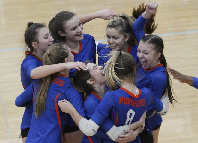 Clockwise from far left, Olentangy Orange's Hanna Borer, Skylar Kelso, Olivia McAtee, Laruen Berend, Kate Moorhead, Makenzie Moll and Molly Shomock celebrate after defeating DeSales in a Division I regional semifinal Nov. 5 at Hilliard Darby.