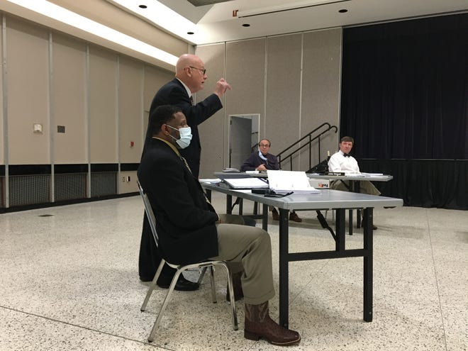 Brett Grayson, attorney for fired Alexandria Police Department Assistant Chief Reginald Cooper, speaks during a meeting Thursday of the Alexandria Municipal Fire and Police Civil Service Board. Cooper is appealing his dismissal.