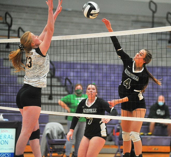 Smithville's Brooke Karlen (4) attacks near the net against Crestview. Karlen led Smithville with a 20-kill performance.