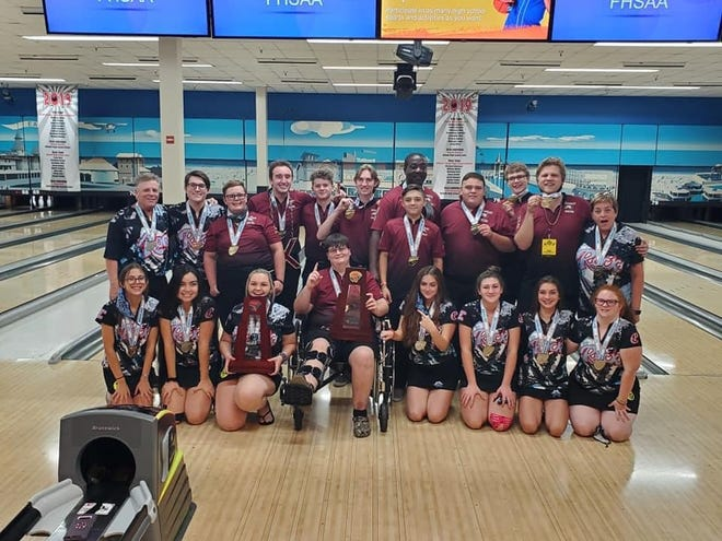 Bowlers from boys state champion Astronaut and girls state runner-up Rockledge pose with their medals and 2020 trophies at Boardwalk Bowl in Orlando. Courtesy of Leslie Shinault