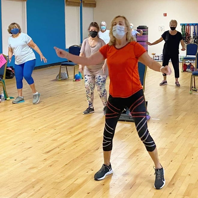 Polly Helm teaches a class at Cocoa Beach Health and Fitness Center. In 2014, Helm received a heart transplant that saved her life.