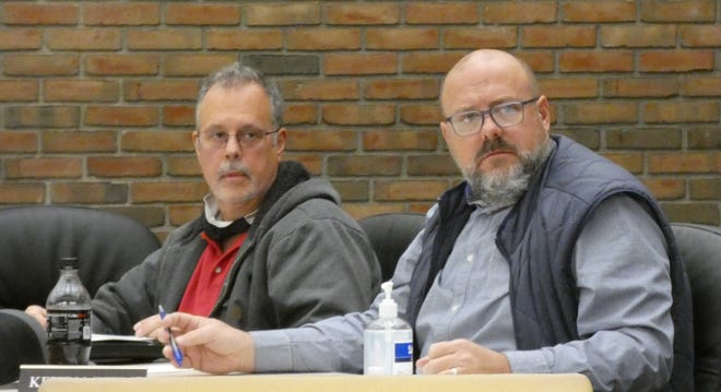 Council member Mark Makeever and Kevin Myers listen to comments during Bucyrus City Council's regular joint committee meeting on Thursday.