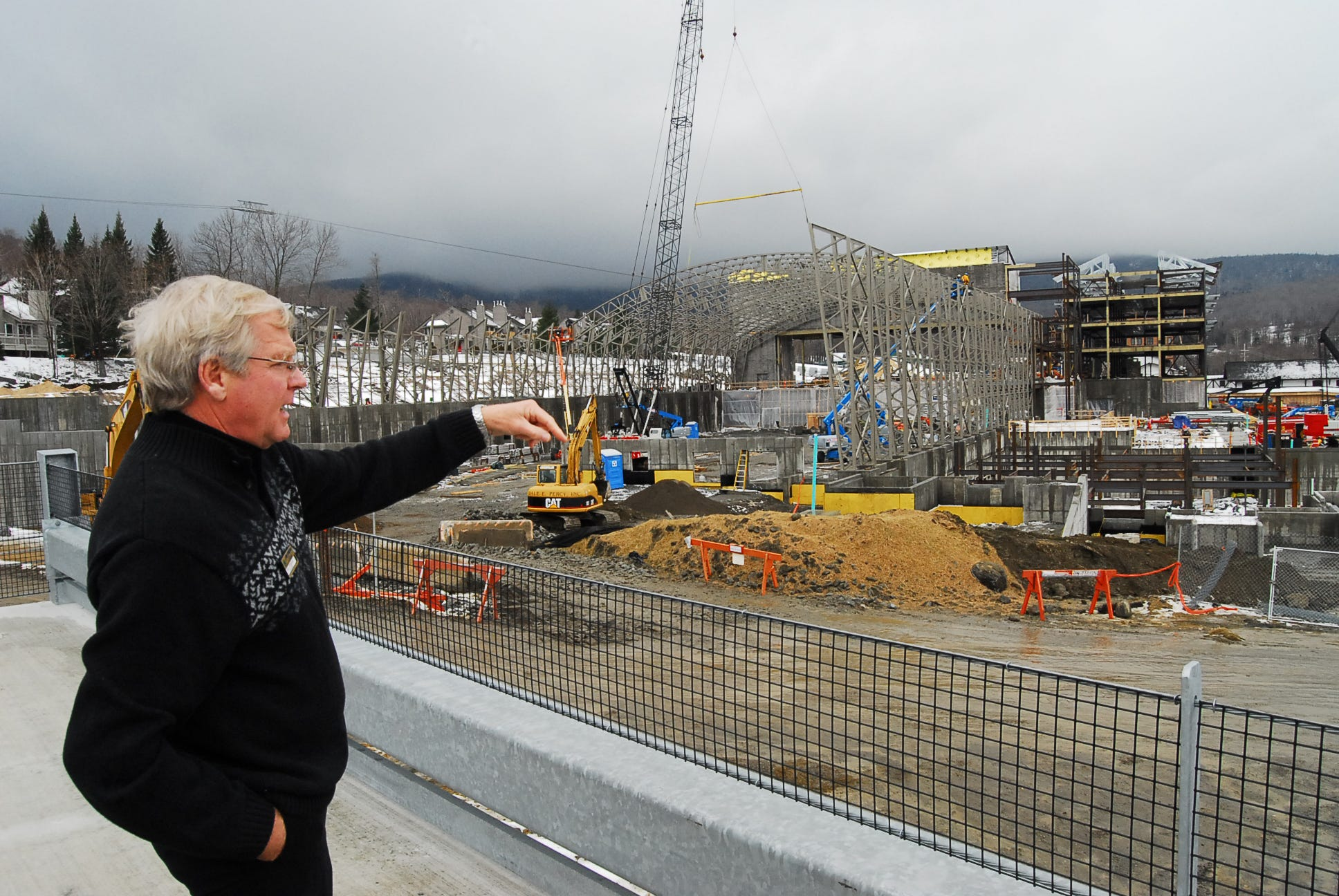 Jay Peak President and CEO Bill Stenger points out progress on the construction of the resort's new indoor water park at the main base area in 2010.