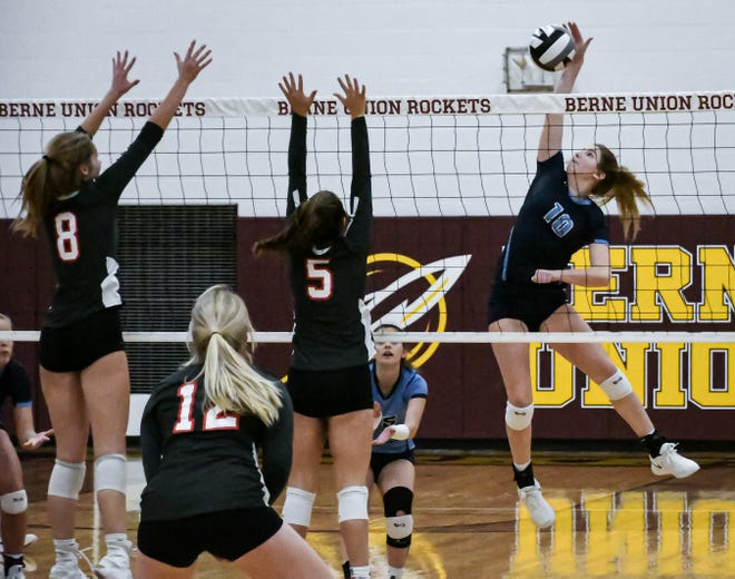 Adena's Hannah Burns spikes the ball during the Warriors'' Division III regional semifinal against Westfall Thursday at Berne Union High School.
