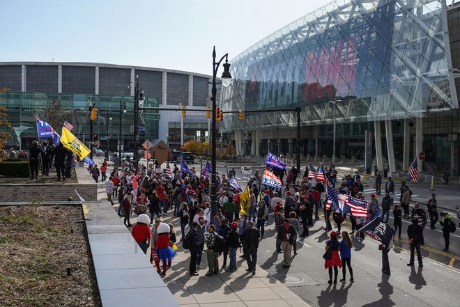 People gather for a rally in support of President Trump outside of the TCF Center in Detroit on Friday, Nov 6, 2020 where the absentee ballot count for the city of Detroit took place. Trump supporters gathered to express their concern for the results after Democratic Presidential Candidate Joe Biden won the State of Michigan turning the state blue.