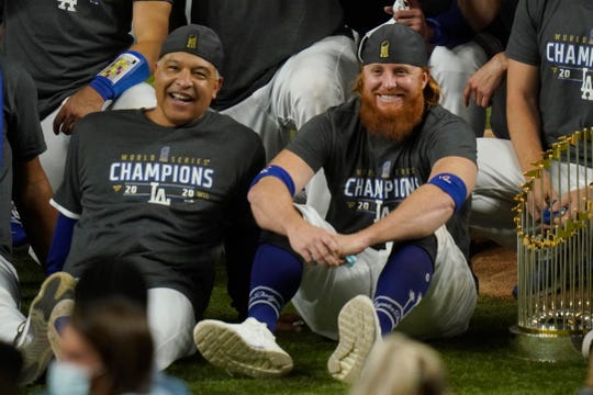 Manager Dave Roberts and third baseman Justin Turner pose for a group picture after the Dodgers won the World Series.
