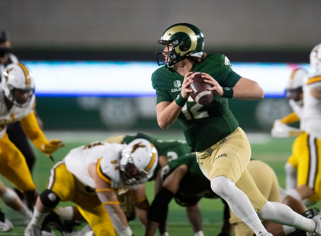 Colorado State Rams quarterback Patrick O'Brien (12) looks to make a pass in the first quarter of the game against the Wyoming Cowboys at Colorado State University in Fort Collins, Colo. on Thursday, Nov. 5, 2020 at Canvas Stadium.