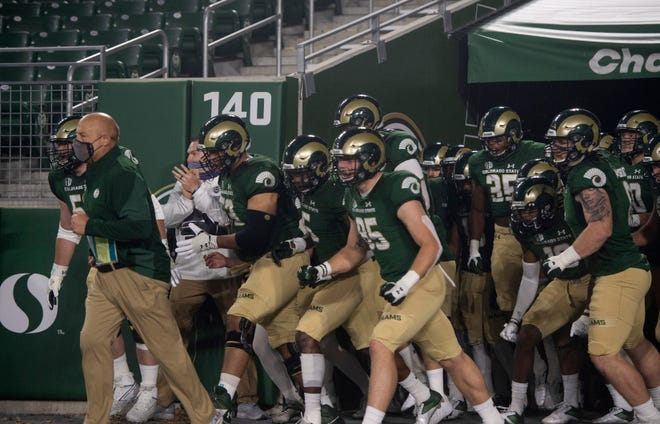 Colorado State Rams head coach Steve Addazio leads his team as they run out onto the field before the game against the Wyoming Cowboys at Colorado State University in Fort Collins, Colo. on Thursday, Nov. 5, 2020 at Canvas Stadium.