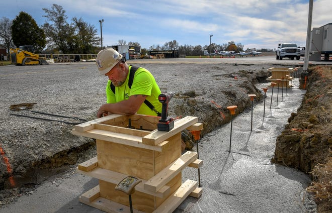 Bryan Miller with ARC Construction frames up what will be a base for a steel column as construction of a new 10,000-square-foot aircraft hanger is underway at the Henderson City-County Airport Thursday, November 5, 2020.