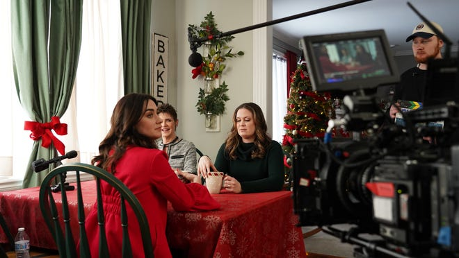 """From left, actors Micah Lynn Hanson, Kim Cruchon Brooks, and Erin Bethea do a scene during production of """"Miracle on Christmas"""" at a home near Brighton in February 2020."""