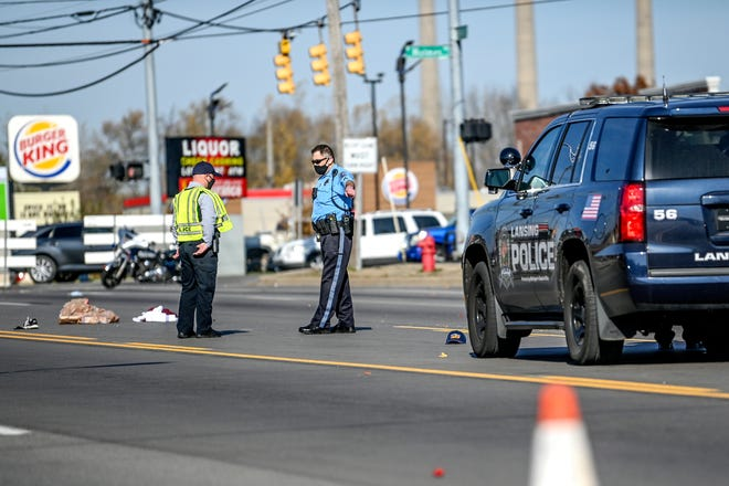 Police investigate the scene of a hit-and-run incident on south Martin Luther King Jr. Boulevard near the Holmes Street intersection on Friday, Nov. 6, 2020, in Lansing.