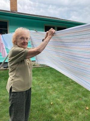 Julia Pillasch hangs laundry