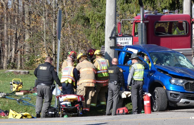 Emergency workers remove the driver of a Ford Ranger from the vehicle following a crash at Ohio 603 and County Road 1475 on Friday afternoon.
