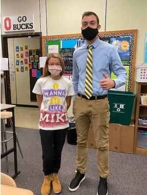 Lexington Eastern Elementary School Principal Michael Grist stands with sixth grade student Amanda Woogerd.