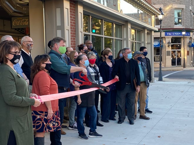 Center Street Market owner and Center Street Community Health CEO Cliff Edwards cuts the ribbon for his new grocery store during a ceremony hosted by the Marion Area Chamber of Commerce Wednesday, Nov. 4, 2020.