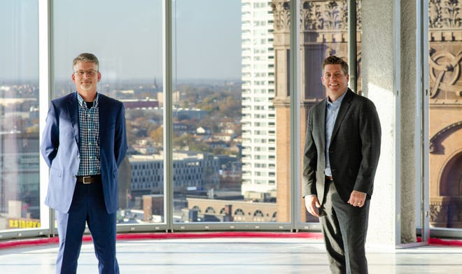 Al Krueger (left) and Glenn Roby, shown last year at Kahler Slater's new headquarters space on the 17th floor of downtown Milwaukee's BMO Tower, have been named the firm's new co-chief executive officers.