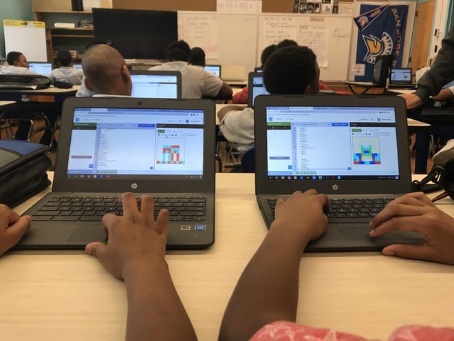Students at Milwaukee Excellence Charter School learn coding using the CODEHS platform.
