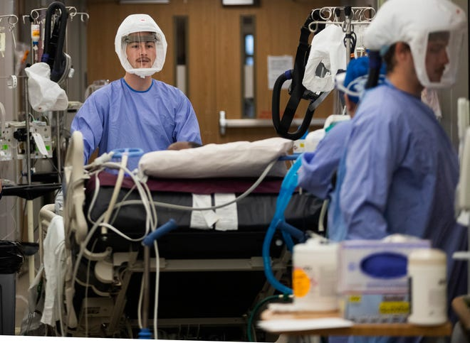 A COVID-19 patient is moved from an intensive care unit Nov. 5 at UW Hospital in Madison. The U.S. is contending with its third, and worst, wave of the virus yet.
