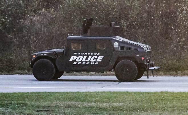 A armored Waukesha County Sheriff's Department vehicle patrols Highway 83 near the intersection of Interstate 94 in Delafield after two officers wear shot early Friday, Nov. 6, 2020. Police arrested a North Dakota man in connection with the nonfatal shootings of two police officers in Delafield.
