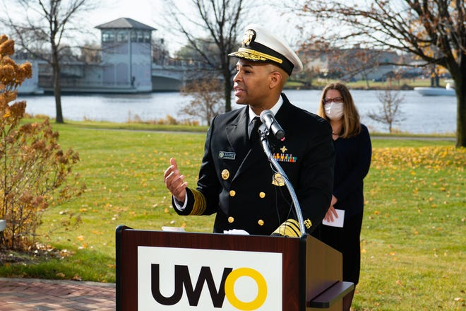 U.S. Surgeon General Jerome Adams speaks during a news conference Friday, Nov. 6, 2020, at the University of Wisconsin-Oshkosh. The UW System and the U.S. Department of Health and Human Services will open surge testing centers at 13 UW campuses to provide free, rapid COVID-19 testing to the public.