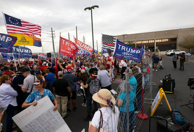 People gather for a protest supporting President Trump outside the Maricopa County Elections headquarters in Phoenix on Nov. 6, 2020.