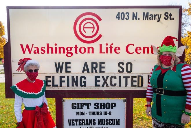 Sandy Malek and Merri Peterson of the St. Clair County Council on Aging's Washington Life Center in Marine City pose for a photo dressed as elves Friday, Nov. 6, 2020 for the Elfed program that received national attention this winter.