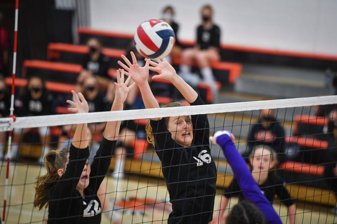 Caitline Springer, left, and Maddison Perring of York Suburban block a kill attempt by Isabela Hoin of Lancaster Catholic during the District 3 Class 3-A girls' volleyball quarterfinal, Thursday, November 5, 2020. 