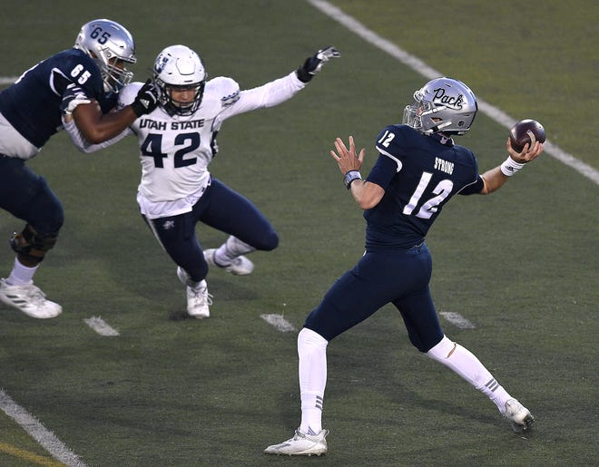 Nevada's Carson Strong throws a pass against Utah State on Thursday.