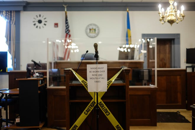 Jurors in Delaware must wear a mask throughout their service. Trial witnesses will be unmasked when behind the plexiglass, and attorneys will be masked except to addressthe judge or askthe witness questions. Monday, Nov. 2, 2020.