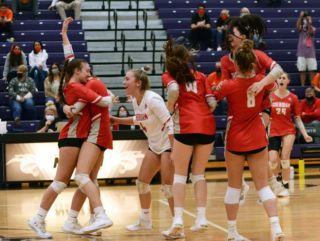 Sheridan players celebrate following a 25-21, 26-24, 20-25, 25-18 win against Meadowbrook in a Division II regional semifinal on Tuesday at Pickerington North. The Generals won their first regional game since 1993.