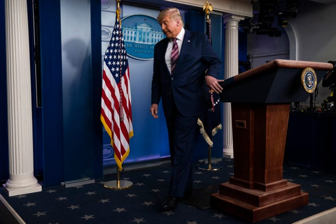President Donald Trump walks off after delivering a statement on the election in the briefing room of the White House, Thursday, Nov. 5, 2020, in Washington.