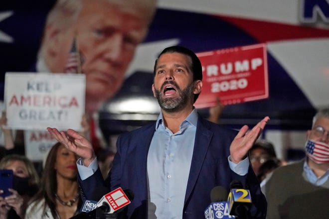 Donald Trump Jr., gestures during a news conference at Georgia Republican Party headquarters Thursday, Nov. 5, 2020 in Atlanta.