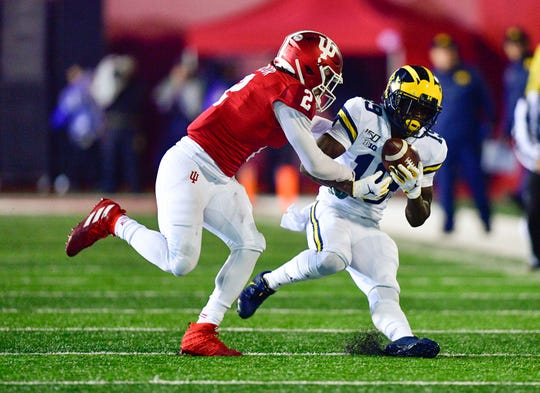 Michigan-based broadcaster Mike Sainristil caught a pass while being defended by Indiana defender Reese Taylor during their 2019 match at Memorial Stadium.
