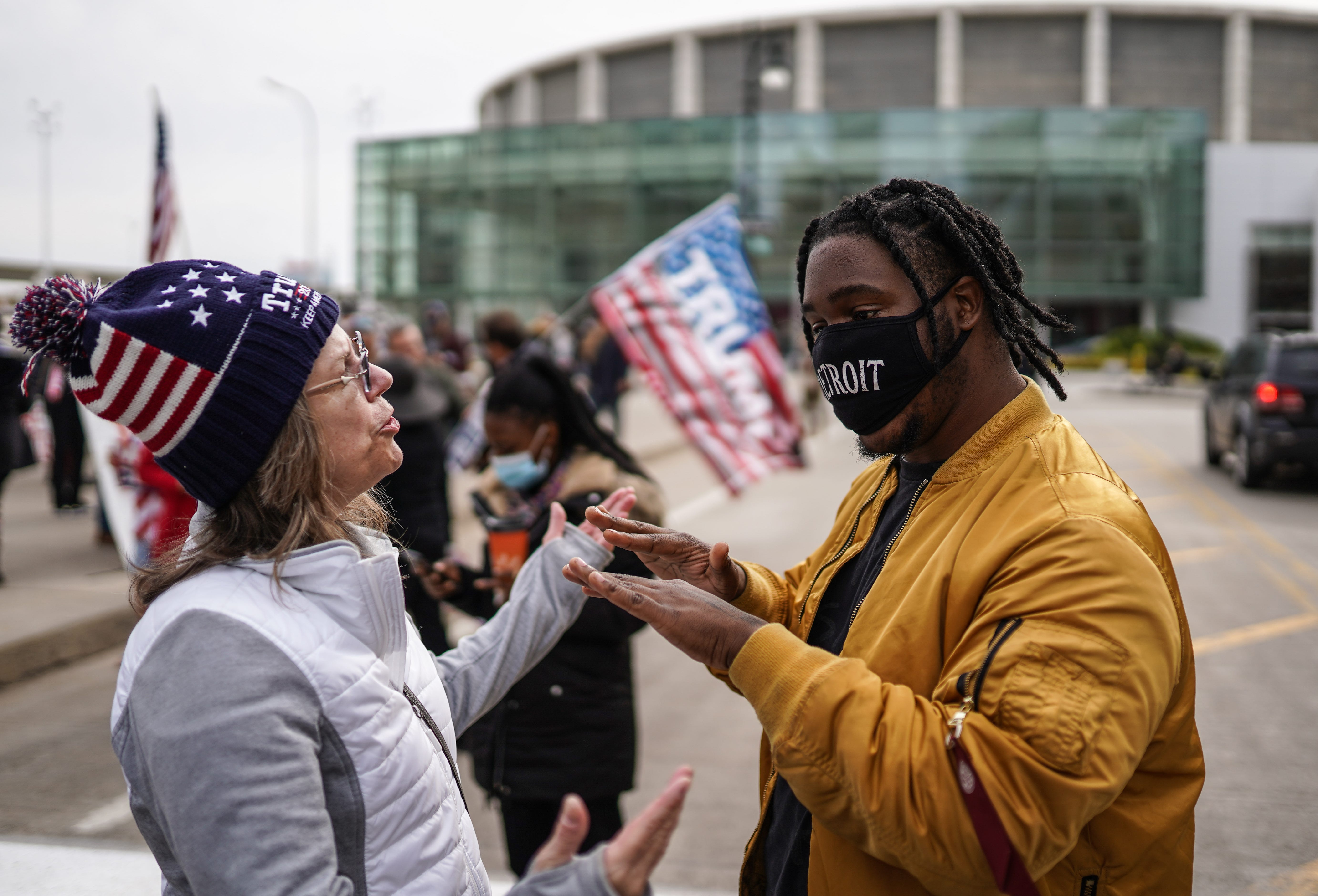 Angelo Austin, right, of Detroit asks a Trump supporter to back away from him since she isn't wearing a mask. Trump supporters gathered outside the TCF Center in Detroit on Nov. 5 as absentee ballots were counted.