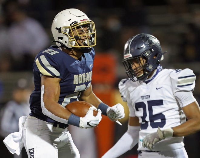 Hoban running back Victor Dawson, left, celebrates after a first down run against Hudson during the first half of a Division II regional final football game, Friday, Nov. 6, 2020, in Akron, Ohio. [Jeff Lange/Beacon Journal]