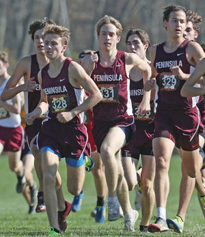 Woodridge runners Ryan Champa, Andrew Lauck, Andrew Shaheen and Aaron Dutt run at the start of the  Div. II 2020 Cross Country State Championship at Fortress Obetz and Memorial park in Obetz, Ohio  on Saturday, Nov. 7, 2020.  [Mike Cardew/Beacon Journal]
