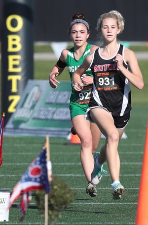 Rittman's Pyper Gibson (front) races Katie Lane of Mogadore to the finish line at the Div. III State Championships on Saturday.
