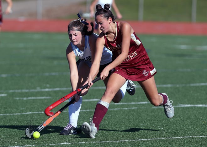 Hudson's Kaci Ramlow and Watterson's Camille Gregory battle for possession during the OHSAA Field Hockey State Final game Nov. 7, 2020, at Thomas Worthington High School in Worthington, Ohio.