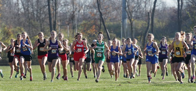 Katie Lane of Mogadore (center) runs at the start of the Division III race at the 2020 Cross Country State Championship, held Saturday at Fortress Obetz and Memorial Park in Obetz, Ohio. [Mike Cardew/Beacon Journal]