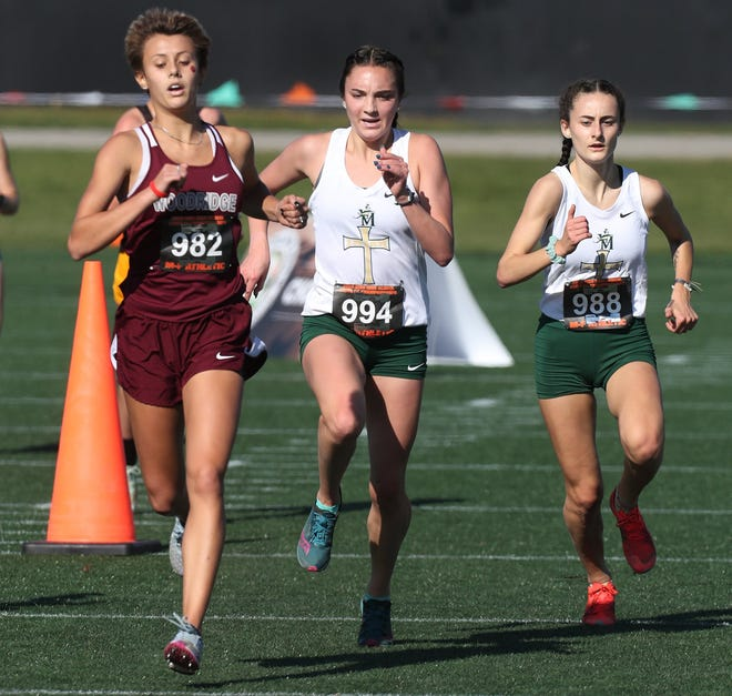 Izzy Best Woodridge races Kate Saum and Theresa Hagey both St. Vincent-St. Mary to the finish line in the Div. II 2020 Cross Country State Championship at Fortress Obetz and Memorial park in Obetz, Ohio  on Saturday, Nov. 7, 2020.  [Mike Cardew/Beacon Journal]