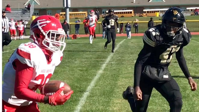 Burlington Township safety Leland Williams (47), shown here chasing Maurice Obanor of Rancocas Valley, blocked a field goal and returned it 75 yards for a touchdown to seal Burlington Township's 21-13 win over Delran Friday.