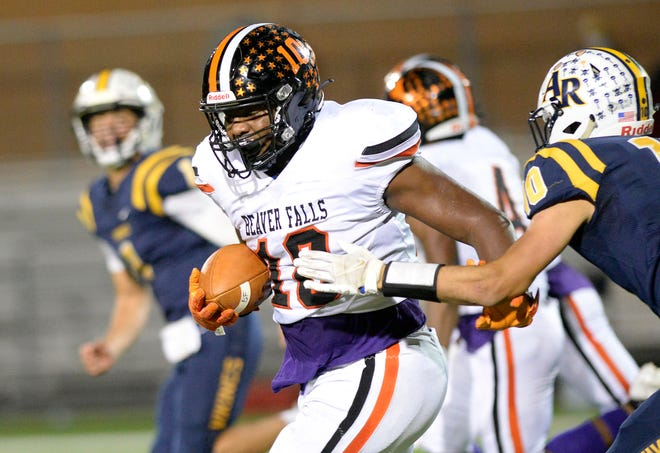 Beaver Falls' Josh Hough breaks free of Apollo-Ridge's Klayton Fitzroy and runs to the end zone during Friday night's WPIAL Class 2A semifinal game at Reeves Field in Beaver Falls.