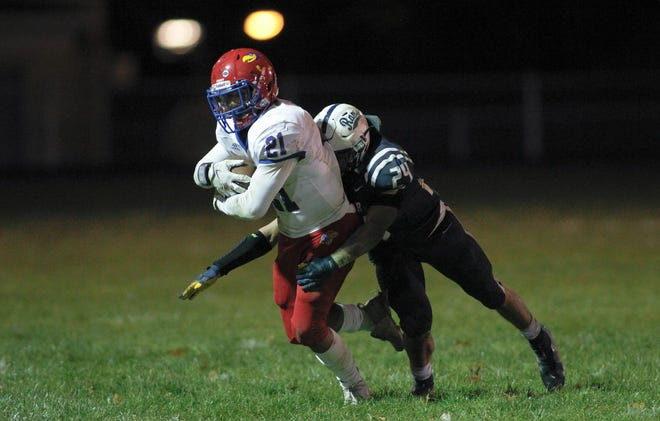 Rochester linebacker Sal Laure (24), shown here making a tackle in a playoff game against Jeannette, was named the 1A Big Seven Conference Defensive Player of the Year.