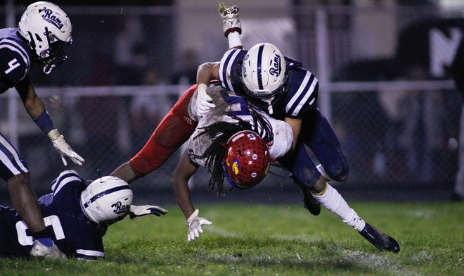 Rochester's Parker Lyons (3) tackles Jeannette's Roberto Smith Jr. (5) to the ground during the second half Friday night at Rochester Area High School.