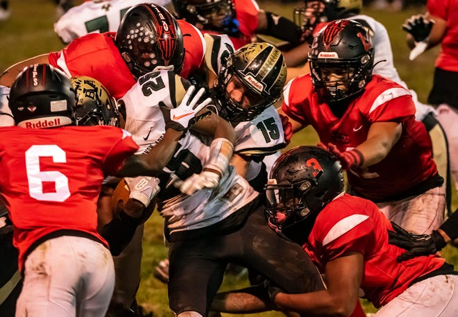 Belle Vernon's Quinton Martin is swarmed by Aliquippa defenders during Friday night's WPIAL Class 4A semifinals.