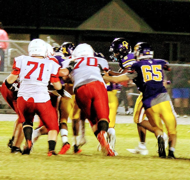 East Beauregard defensive linemen Dakota Kemp (70) and Evan Stevens (71) converge on the tackle during the Trojans' loss Friday night at Oberlin.